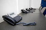 Landline telephones on table in television studio