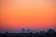 UNITED KINGDOM, London: 27 April 2017 A red and yellow sky is cast over the towers of Canary Wharf as the sun begins to rise on a cold day in London this morning. Rick Findler / Story Picture Agency