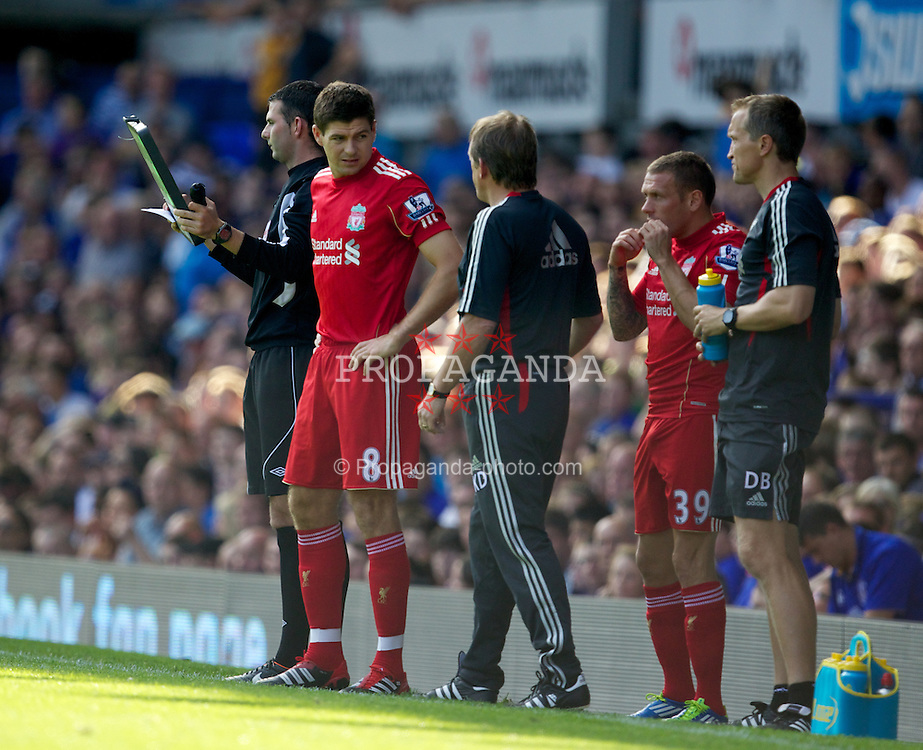 LIVERPOOL, ENGLAND - Saturday, October 1, 2011: Liverpool's manager Kenny Dalglish talks to captain Steven Gerrard MBE during the Premiership match against Everton at Goodison Park. (Pic by Vegard Grott/Propaganda)