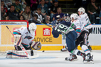 KELOWNA, CANADA - APRIL 22: Michael Herringer #30 of Kelowna Rockets makes a save on a shot by Donovan Neuls #19 of Seattle Thunderbirds on April 22, 2016 at Prospera Place in Kelowna, British Columbia, Canada.  (Photo by Marissa Baecker/Shoot the Breeze)  *** Local Caption *** Michael Herringer; Donovan Neuls;