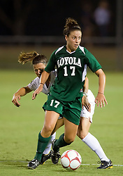 Loyola Greyhounds midfielder Kelly Farrell (17) is defended by Virginia Cavaliers midfielder/forward Kelly Quinn (10).  The #6 Virginia Cavaliers defeated the Loyola College Greyhounds 4-0 in a NCAA Women's Soccer game held at Klockner Stadium on the Grounds of the University of Virginia in Charlottesville, VA on August 22, 2008.