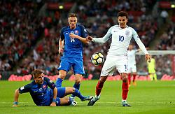 Dele Alli of England is tackled by Peter Pekarik of Slovakia - Mandatory by-line: Robbie Stephenson/JMP - 04/09/2017 - FOOTBALL - Wembley Stadium - London, United Kingdom - England v Slovakia - 2018 FIFA World Cup Qualifier