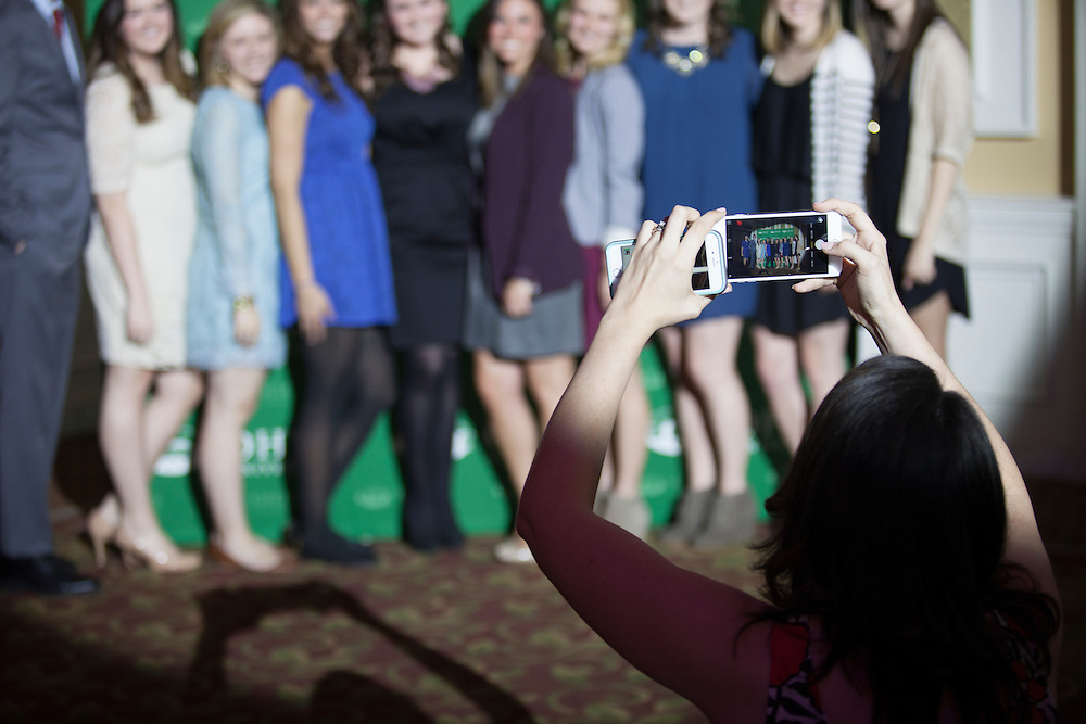 A group of people line up to get their photo taken at Ohio University's 33rd Annual Leadership Awards Gala in Baker Ballroom on April 7, 2016. ©Ohio University/ Photo by Kaitlin Owens
