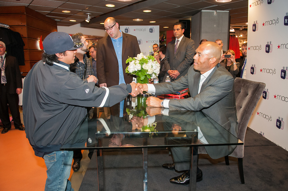 Mariano Rivera signs baseballs and fragrance bottles at Macy's department store in Midtown Manhattan for the NY Yankees fragrance launch. Photos by Tiffany L. Clark