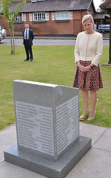 HRH the Countess of Wessex visits the Riverhill Regeneration project in Cobham Surrey on 9th July 2014.<br /> Picture shows:-The COUNTESS OF WESSEX views the recently constructed war memorial.