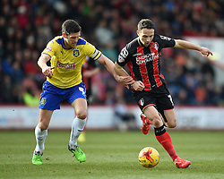 Huddersfield Town captain Mark Hudson challenges Bournemouth's Marc Pugh - Photo mandatory by-line: Paul Knight/JMP - Mobile: 07966 386802 - 14/02/2015 - SPORT - Football - Bournemouth - Goldsands Stadium - AFC Bournemouth v Huddersfield Town - Sky Bet Championship