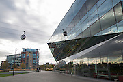 An Emirates Air Line Cable Car passes by The Crystal building in Royal Victoria Docks London, England, United Kingdom.  The Air Line opened in 2012  and was built by Doppelmayr with sponsorship from the airline Emirates.  The Crystal Building is one of the worlds most sustainable buildings and events venue.  (photo by Andrew Aitchison / In pictures via Getty Images)