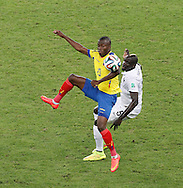 Enner Valencia of Ecuador (L) and Mamadou Sakho of France (R) during the 2014 FIFA World Cup Group E match at Maracana Stadium, Rio de Janeiro<br /> Picture by Andrew Tobin/Focus Images Ltd +44 7710 761829<br /> 25/06/2014