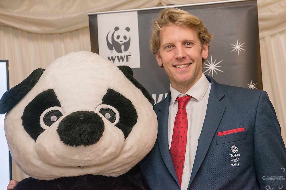 Andrew Triggs Hodge OBE with Panda at WWF UK Earth Hour 10th Anniversary Parliamentary Reception, Terrace Pavilion, Palace of Westminster. 28th Feb. 2017