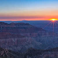 Sun rises over the Grand Canyon, as seen from Point Imperial, North Rim. Grand Canyon National Park, Arizona