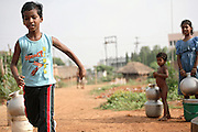 Budhia Singh, (left) 6, the famous Limca World Record marathoner, is training on the roads near his home in Salia Sahi slum (pop. 30.000) of Bhubaneswar, the capital of Orissa State, on Sunday, May 18. On May 1, 2006, Budhia completed a record breaking 65 km run from Jagannath temple, Puri to Bhubaneswar. He was accompanied by his coach Biranchi Das and by the Central Reserve Police Force (CRPF). On 8th May 2006, a Government statement had ordered that he stopped running. The announcement came after doctors found the boy had high blood pressure and cardiological stress. As of 13th August 2007 Budhia's coach Biranchi Das was arrested by Indian police on suspicion of torture. Singh has accused his coach of beating him and withholding food. Das says Singh's family are making up charges as a result of a few petty rows. On April 13, Biranchi Das was shot dead in Bhubaneswar, in what is believed to be an event unconnected with Budhia, although the police is investigating the case and has made an arrest, a local goon named Raja Archary, which is now in police custody. **Italy and China Out**