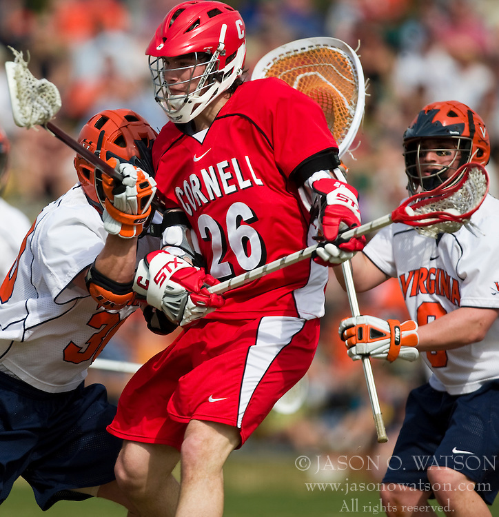 Cornell Big Red A Ryan Hurley (26) is checked by Virginia Cavaliers M Brian Carroll (36).  The #1 ranked Virginia Cavaliers defeated the #4 ranked Cornell Big Red 14-10 at Klockner Stadium on the Grounds of the University of Virginia in Charlottesville, VA on March 8, 2009.