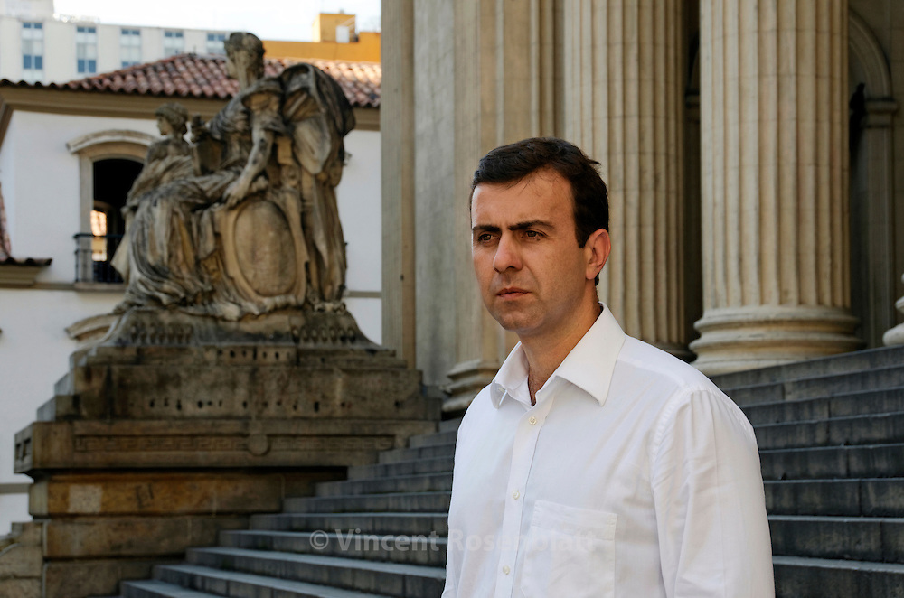 "Deputy Marcelo Freixo, in front of the Legislative Assembly of the state of Rio de Janeiro. Chairman of the Commission of Human Rights, he lives under constant police protection since he launched in 2008 a parliamentary commission of inquiry (CPI) on the paramilitary militias that dominate hundreds of neighborhoods and favelas of Rio, resulting in the arrest and the indictment of several members, policemen and politicians. Candidate for mayor of Rio for the 2012 elections. He inspired one of the main caraters of the Brazilian movie ""Tropa de Elite II"" //..Le député Marcelo Freixo, devant l'Assemblée législative de l'état de Rio de Janeiro. President de la Comission des Droits de l'Homme, il vit constamment sous protection policière  depuis qu'il a lancé en 2008 une Commission d'Enquête Parlementaire sur les milices paramilitaires qui dominent des centaines de favelas et quartiers de Rio, provocant l'arrestation et la mise en examen de nombreux députés, policiers et hommes politiques. Candidat à la Mairie de Rio pour les élections de 2012."