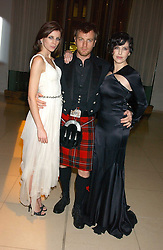 Left to right, LIBERTY ROSS, EWAN McGREGOR and SHARLEEN SPITERI at a Burns Night supper in aid of Clic Sargent & Children's Hospital Association Scotland hosted by Ewan McGregor, Sharleen Spieri and Lady Helen Taylor at St.Martin's Lane Hotel, 45 St Martin's Lane, London on 25th January 2006.<br />