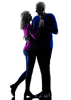 one caucasian couple senior lovers dancing  silhouette  in silhouette studio isolated on white background