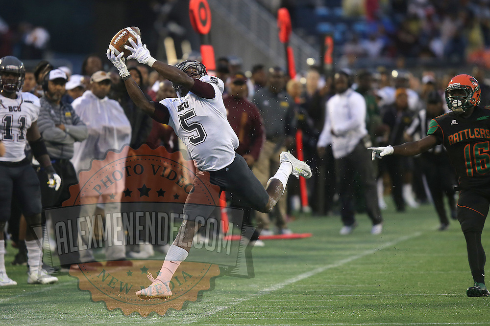 Bethune Cookman receiver Jhomo Gordon (5) steps out of bounds on a reception during the Florida Classic NCAA football game between the FAMU Rattlers and the Bethune Cookman Wildcats at the Florida Citrus bowl on Saturday, November 22, 2014 in Orlando, Florida. (AP Photo/Alex Menendez)