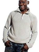 Casual mature afro American man standing smiling in studio with hands in pocket on isolated white background