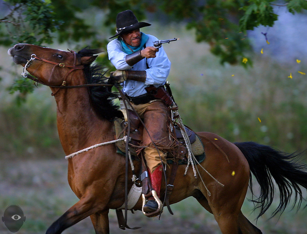 One Hawk blasts a balloon into pieces while in a full gallop shot with his pistol filled with black powder during a gathering of the Oregon Rough Riders.