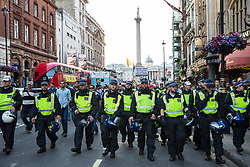 London, UK. 10th June, 2018. Police officers in riot gear lead hundreds of people taking part in the pro-Palestinian Al Quds Day march through central London organised by the Islamic Human Rights Commission. An international event, it began in Iran in 1979. Quds is the Arabic name for Jerusalem.