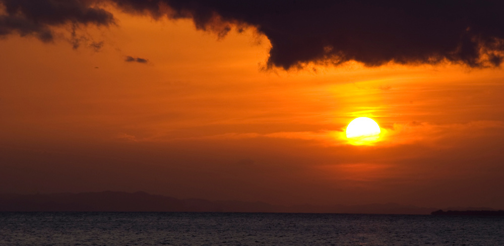 A Nica sunset to remember from the harbor of Mayogalpa on Isla Ometepe, Nicaragua.