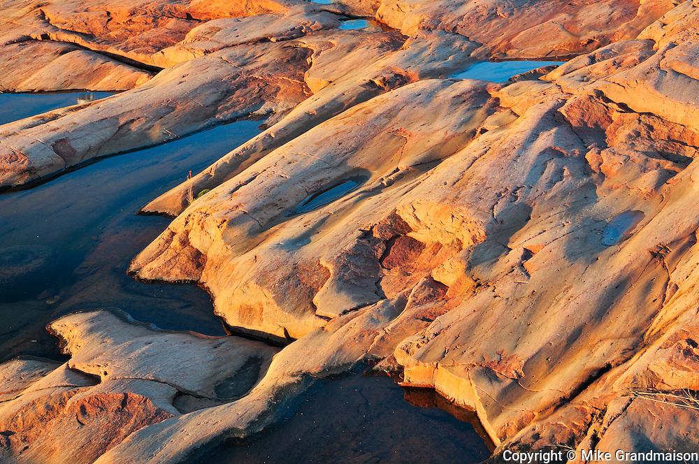 Rocks of precambrian shield at sunrise<br /> Killarney Provincial Park<br /> Ontario<br /> Canada