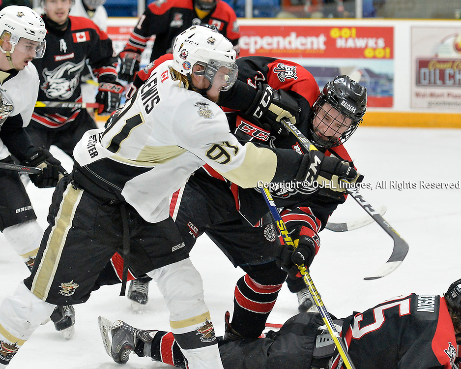 TRENTON, ON  - APR 15,  2017: Ontario Junior Hockey League, Championship Series.  Georgetown Raiders vs the Trenton Golden Hawks in Game 2 of the Buckland Cup Final.  Mac Lewis #91 of the Trenton Golden Hawks makes the hit on Mitch Brewer #3 of the Georgetown Raiders during the first period.<br /> (Photo by Shawn Muir / OJHL Images)