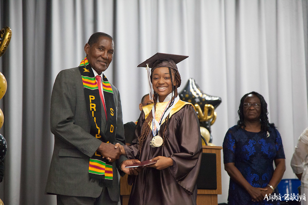 M'Kaylah Sullivan receives her diploma from principal Dr. Whitman Brown.  St. Thomas/St. John Seventh Day Adventist School Commencement Service.  Bertha C. Boschulte Auditorium.  St. Thomas, USVI.  12 June 2016.  © Aisha-Zakiya Boyd