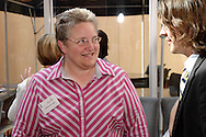 Janette Dwyasuk of Ferguson Construction Company (left) and Richard Kaiser of Penny/Ohlmann/Neiman during a BBB/Women in Business Networking event in the atrium of the Kuhn Building in downtown Dayton, Thursday, July 14, 2011.