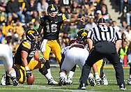 September 22 2012: Iowa Hawkeyes quarterback James Vandenberg (16) points to the defense during the first half of the NCAA football game between the Central Michigan Chippewas and the Iowa Hawkeyes at Kinnick Stadium in Iowa City, Iowa on Saturday September 22, 2012. Central Michigan defeated Iowa 32-31.