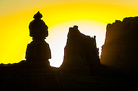Rock formations silhouetted at sunrise, Goblin Valley State Park, Utah, USA.