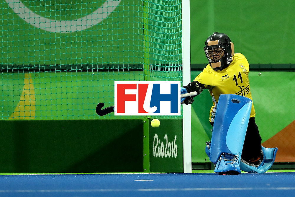RIO DE JANEIRO, BRAZIL - AUGUST 08:  Savita Savita #11 of India blocks a shot on goal against Great Britain during a Women's Pool B match on Day 3 of the Rio 2016 Olympic Games at the Olympic Hockey Centre on August 8, 2016 in Rio de Janeiro, Brazil.  (Photo by Sean M. Haffey/Getty Images)