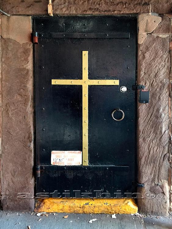 Black door in brown wall.