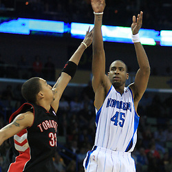 06 February 2009:  New Orleans Hornets guard Rasual Butler (45) shoots over Toronto Raptors forward Jamario Moon (33) during a 101-92 win by the New Orleans Hornets over the Toronto Raptors at the New Orleans Arena in New Orleans, LA.