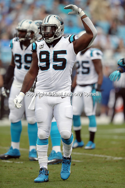Carolina Panthers defensive end Charles Johnson (95) waves while trying to fire up the crowd during the 2015 NFL week 3 regular season football game against the New Orleans Saints on Sunday, Sept. 27, 2015 in Charlotte, N.C. The Panthers won the game 27-22. (©Paul Anthony Spinelli)