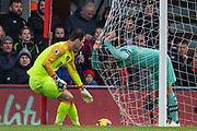 Asmir Begovic (GK) (Bournemouth) retrieves the ball with Sead Kolasinac (Arsenal) in the net following a wide ball during the Premier League match between Bournemouth and Arsenal at the Vitality Stadium, Bournemouth, England on 25 November 2018.