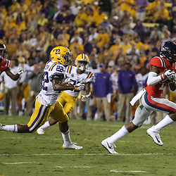 Sep 29, 2018; Baton Rouge, LA, USA; Mississippi Rebels wide receiver Braylon Sanders (13) runs past LSU Tigers cornerback Kristian Fulton (22) during the first quarter of a game at Tiger Stadium. Mandatory Credit: Derick E. Hingle-USA TODAY Sports