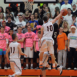 TOM KELLY IV &mdash; DAILY TIMES<br /> Marple Newtown's Nick Giordano blocks a layup from Garnet Valley's Andrew Louden (5) during the Garnet Valley at Marple Newtown boys basketball game on Tuesday night December 9, 2014.