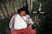 Villager sleeping off his drunkenness in the graveyard on the Day of the Dead, Todos Santos de Cuchumatan, Guatemala.