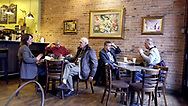 Five people enjoy coffee and conversation on 27 January 2020 at The Coffee Exchange in Windsor, Ontario.