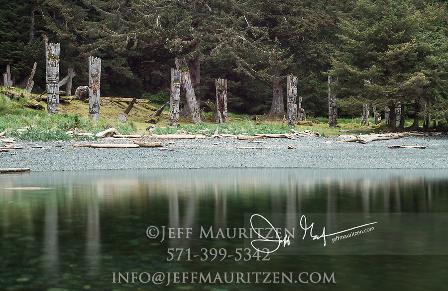 Standing mortuary poles at Ninstints on Sgang Gwaay, a UNESCO World Heritage Site at Gwaii Haanas National Park, British Columbia, Canada