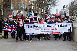 PLACE, January 14 2018. A few dozen protesters from 'The People's Charter' group demonstrate outside Downing Street demanding that the Brexit referendum result is respected following calls for a second referendum. PICTURED: The group pose for a photograph before disbanding. © Paul Davey