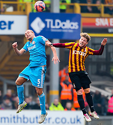 Sunderland's Wes Brown challenges for a header with Bradford City's Jon Stead  - Photo mandatory by-line: Matt McNulty/JMP - Mobile: 07966 386802 - 15/02/2015 - SPORT - Football - Bradford - Valley Parade - Bradford City v Sunderland - FA Cup - Fifth Round