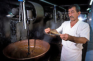 SAFRANBOLU, TURKEY AUGUST 2003. The foreman checks the viscosity of  the mix for Turkish Delight at the Safrantat factory. The city of Safranbolu positioned in the forests on the Black Sea coast is one of the world heritage sites of the UNESCO. Apart from its Ottoman era wood and mudbrick houses it is also known for its 'Lokum' or Turkish delight. A delicate sweets with flavours from nuts to rose petals. Photo by Frits Meyst/Adventure4ever.com