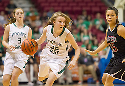 Wyoming East guard Gabby Lupardus (32) looks for open space against Bluefield during a first round game at the Charleston Civic Center.