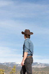 cowboy looking out towards a mountain range