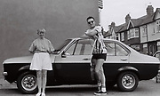 Couple pose with their new Ford Escort Mkll, Southall, London, UK, 1987.