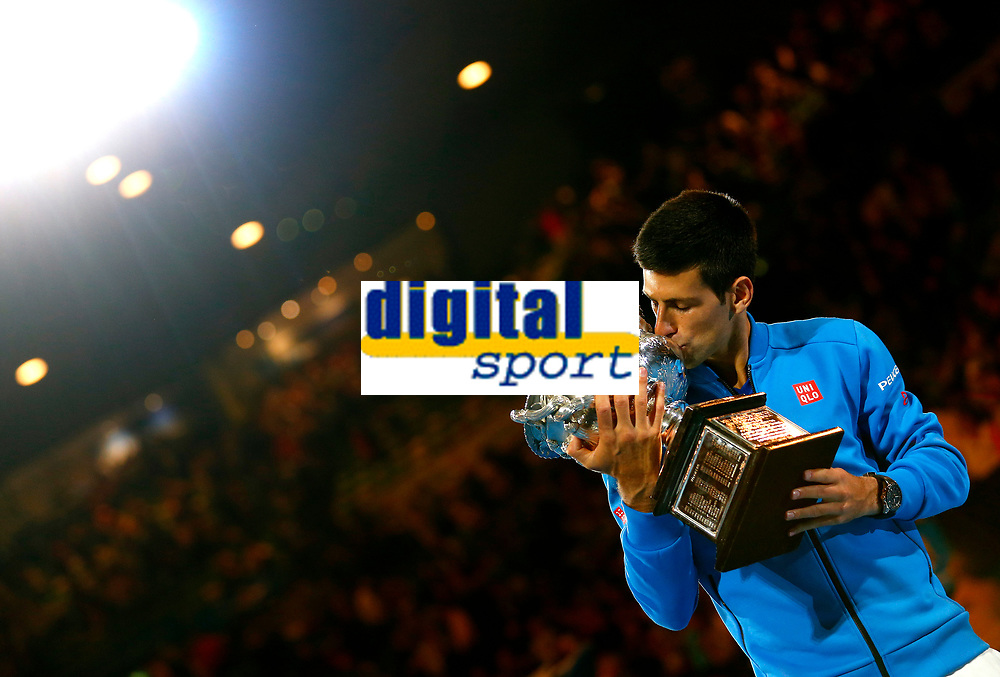 Novak Djokovic of Serbia celebrates with the trophy during the final of the Australian Open 2015 Grand Slam, Tennis match day 14, on February 1, 2015 in Melbourne, Australia. Photo Ella Ling / Backpage Images / DPPI
