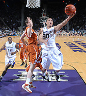 ESPN -- Kansas State Wildcats forward Michael Beasley (30) glides past Texas Longhorns forward Connor Atchley (32) in the first half, for two of his game high 30-points against the Longhorns at Bramlage Coliseum in Manhattan, Kansas.