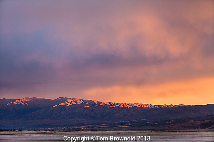 A winter storm moving effecting the sunrise over the Grapevine Mountains. Image made from the Middle Basin of Death Valley and Salt Creek.