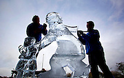 Repro Free: 06/11/2012 .Sculpters, Daniel Doyle and Andrew Clancy are pictured creating a giant ice sculpture at the launch of Ireland's largest ice rink, I-Skate@The RDS running from November 16th to January 13th. Pic Andres Poveda..Measuring 1,000 square metres, I-Skate will be the largest rink operating in Ireland this year. Because the rink is so large it is expected that, despite a projected attendance of 100,000+, at all times skaters will have plenty of room to enjoy themselves.?.For those looking for a more stationary form of entertainment ice sculptures and ice sculpting demonstrations will be held on the 16th & 17th of November and the 8th & 9th of December. To book tickets, find out about opening times or the facilities available to families and junior skaters or even to book yourself a hockey match just visit www.iskate.ie .?.